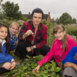 BBC's Cell Spellman with winners of the WWF-UK Plant2Plate competition. Student's Cottage Pie recipe created by students at The The Oval Primary School, Yardley, Birmingham received the £1000 prize.